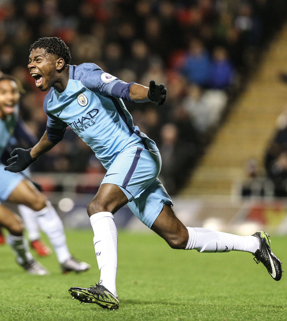 Manchester City's Isaac Buckley Ricketts-celebrates scoring against Manchester United