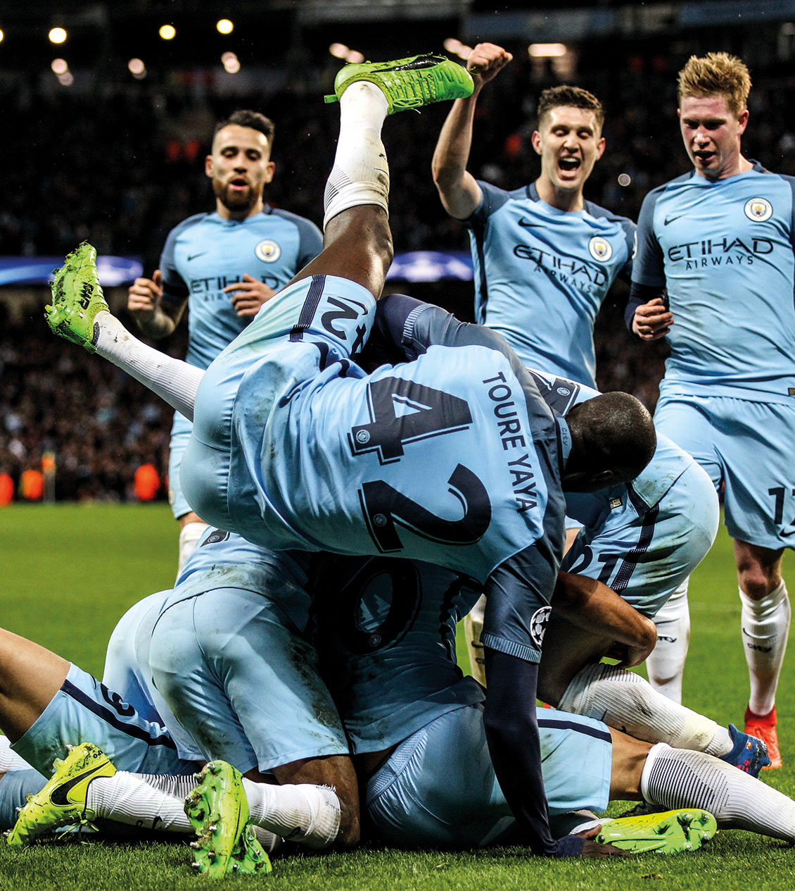 Manchester City's Leroy Sane celebrates scoring against Monaco with his teammates Yaya Toure, John Stones, Kevin De Bruyne